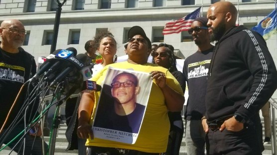 lacey - Outside the Hall of Justice in Los Angeles on March 2, 2020, Sherlyn Haynes holds a photo of her son Christopher Mitchell who was shot and killed by police at a grocery store in 2018. She and other members of the local chapter of Black Lives Matters say the shooting was unjustified and want to meet with District Attorney Jackie Lacey to discuss police accountability. | Photo: Nathan Solis / CNS.