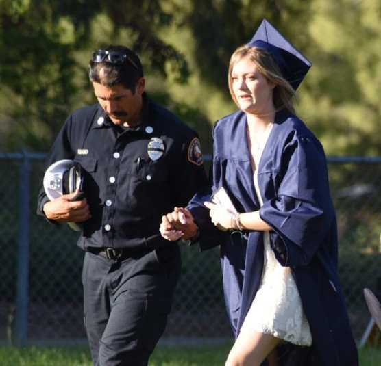 Firefighter Escorts Tony Carlon's Daughter During Graduation