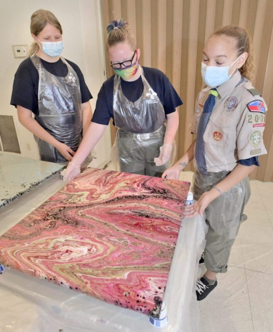 Female Scouts Creating Art