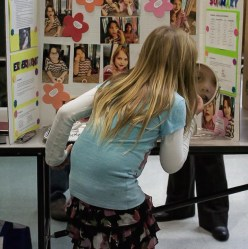 Girl applies makeup at one of the booths