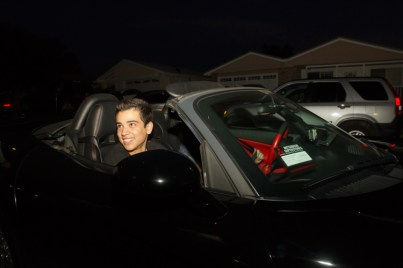 Justin beams when he returns from riding in the Dodge Viper at z fundraiser.