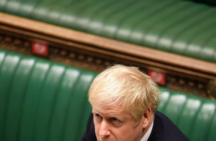 """Boris Johnson defended his belated decision to impose a second coronavirus lockdown—but the opposition derided a """"catastrop"""