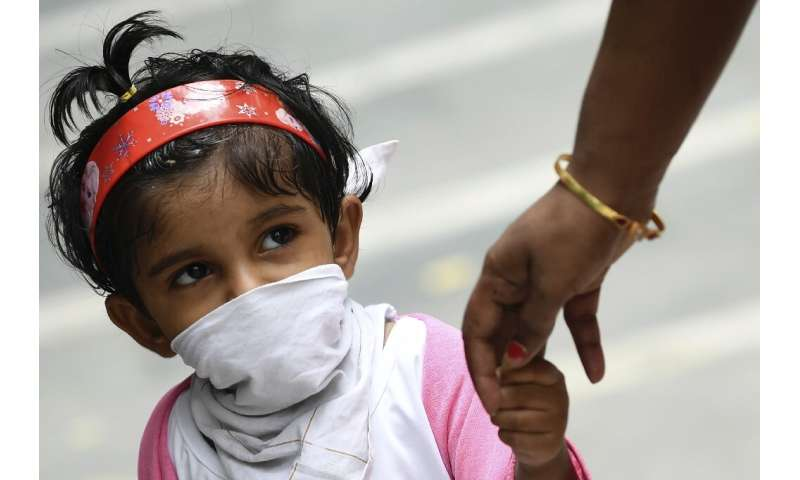 India is gradually easing a nationwide lockdown despite setting a daily record of 18,500 new cases and 385 deaths on Saturday