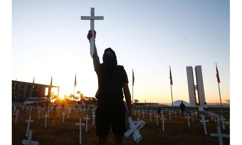 One of thousands of protesters demonstrating across Brazil against the pandemic response of President Jair Bolsonaro