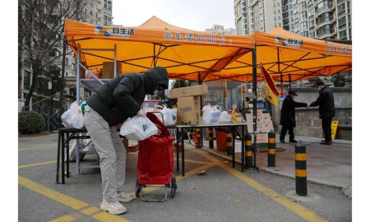 Virus fuels dread and angst even as China sees signs of hope