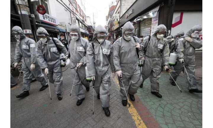 S. Korea hunts sick beds as West braces for long virus fight