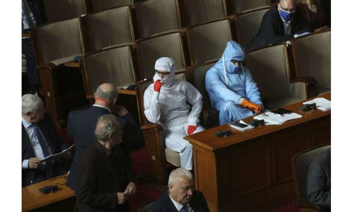 Europe's south strains under pandemic; 10,000 die globally