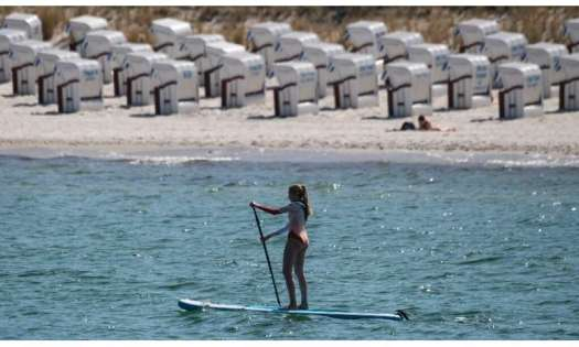 A woman on her paddle board at the seaside resort of Binz, on the island of Ruegen in northeastern Germany.