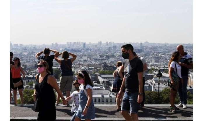 People must now wear masks at Paris spots like Montmartre, famous for its viewover the French capital's skyline