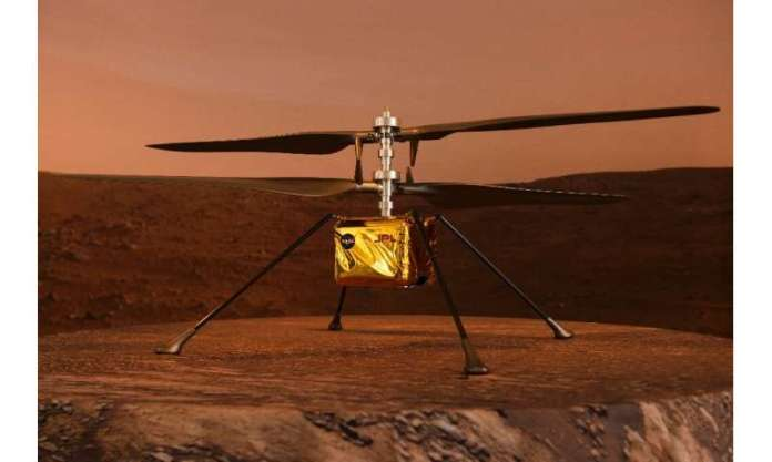 A full scale model of the experimental Ingenuity Mars Helicopter, which will be carried under the Mars 2020 Perseverance rover,