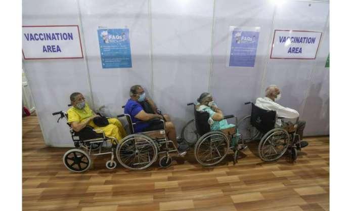 India fights virus surge, steps up jabs amid export row