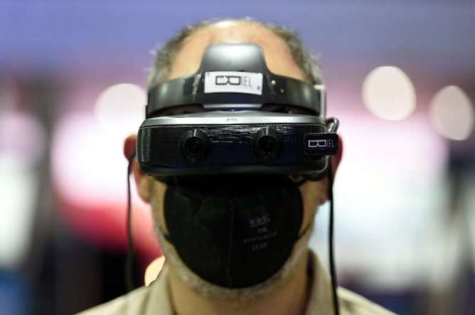 A man uses Biel digital glasses that help people with limited sight better perceive their surroundings