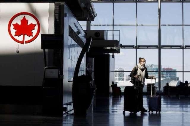 Un logo d'Air Canada à l'aéroport international Pearson de Toronto - la compagnie aérienne réduit son personnel en raison de Covid-19