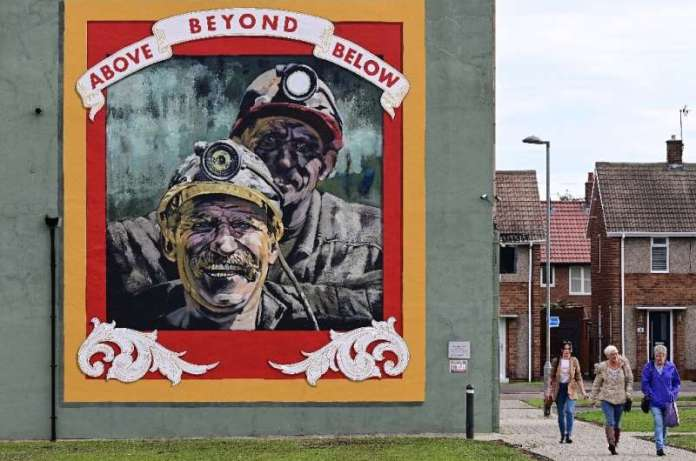 Landmarks around Seaham like a mural by artist Cosmo Sarson remind of the town's coal-mining past