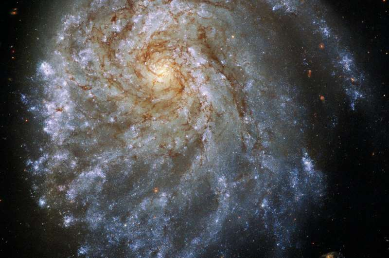 Magnificent spiral galaxy is being stretched by gravity from bypassing neighbor