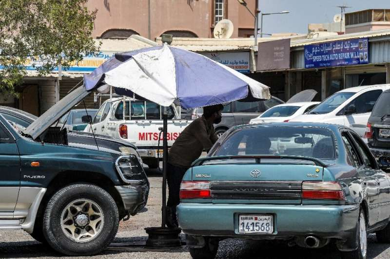 Oil-rich Gulf faces prospect of unlivable heat as planet warms  Mechanics work in Isa Town, south of Bahrain's capital Manama. Average summer temperatures in the country range between 35C and