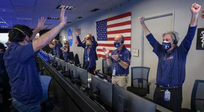 Members of NASA's Perseverance rover team react in mission control after receiving confirmation that the spacecraft successfully