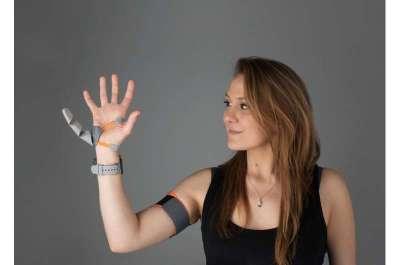 Designer Dani Clode with her 'Third Thumb' device. Credit: Dani Clode  Robotic 'Third Thumb' use can alter brain representation of the hand | Tech Xplore MAY 19, 2021 / Robotics / Engineering   https://techxplore.com/news/2021-05-robotic-thumb-brain-representation.html