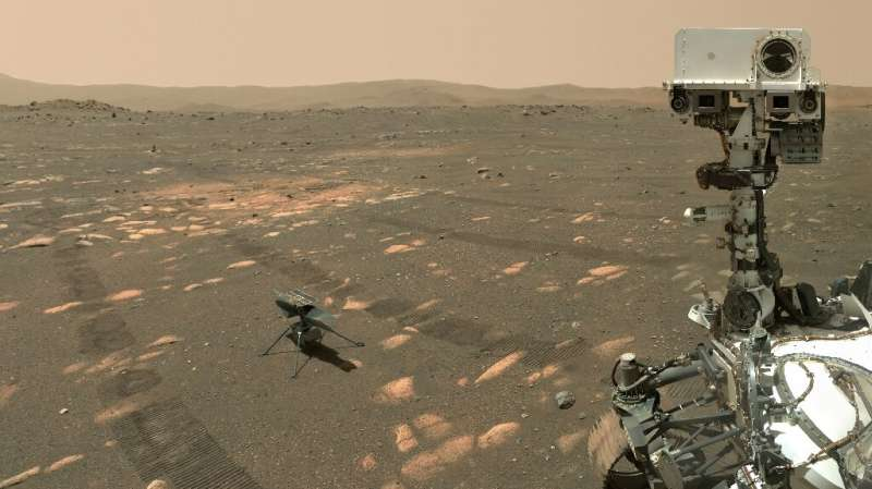 This NASA photo shows the Perseverance Mars rover in a selfie with the Ingenuity helicopter, seen here about 13 feet (3.9 meters