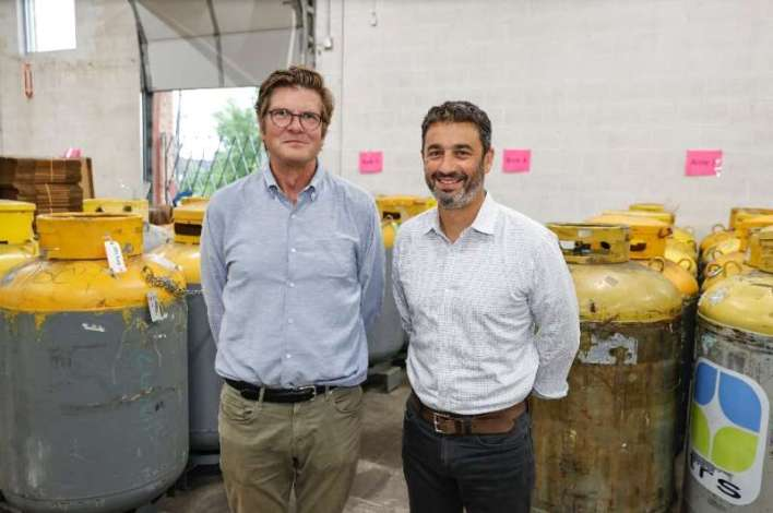 Tim Brown (L) and Gabriel Plotkin (R) of Tradewater pose for a picture at their warehouse in Elk Grove Village, Illinois