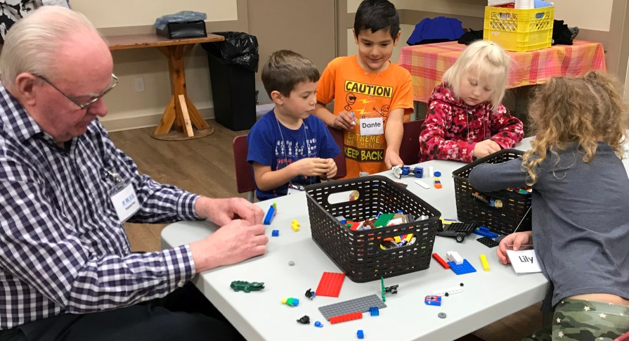 group playing lego