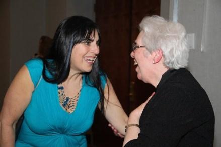 Carol Sanderson congratulates Janet Bucholdt on her Lifetime Achievement Award (EDSymposium16)