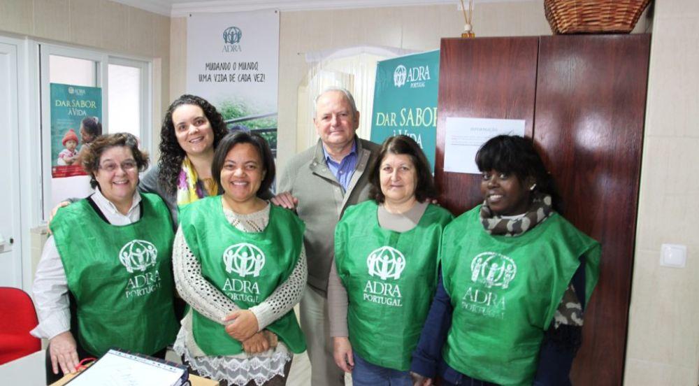 ADRA International president Jonathan Duffy, back center, meeting with ADRA volunteers in Portugal. (ADRA)
