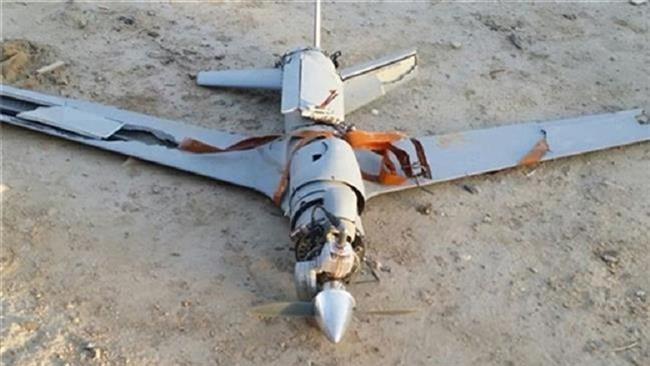 حطام طائرة سعودية من دون طيار أسقطتها القوات اليمنية في مكان لم يكشف عنه (Press TV)