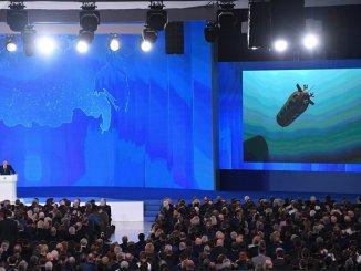 الرئيس الروسي فلاديمير بوتين خلال الرسالة السنوية للجمعية الفدرالية في 1 آذار/ مارس (سبوتنيك)