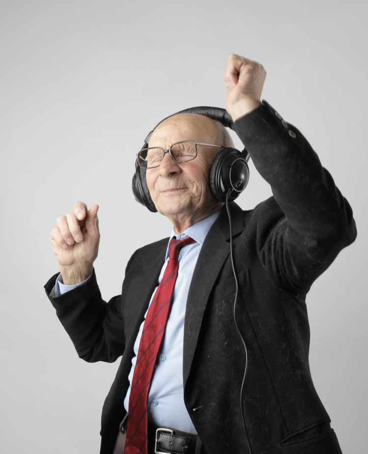 Elderly gentleman enjoying music on headphones
