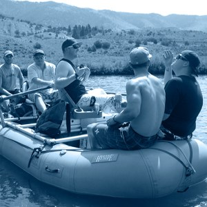 Blue gradient map image of people rafting.