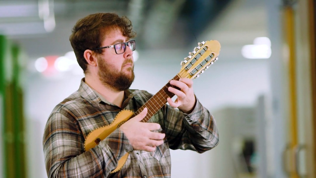SDI employee playing ukulele