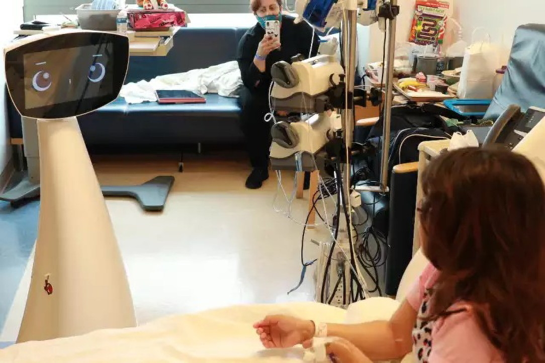 Robin the robot interacts with a patient in the UCLA Mattel Children's Hospital's Chase Child Life Program in Los Angeles, California. (UCLA Health/Newsflash, Zenger)