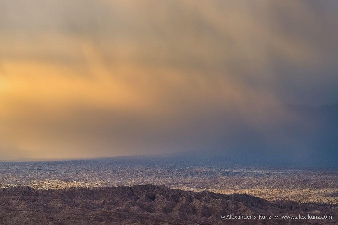 Alexander S. Kunz: Rain Over Empty Desert Landscape