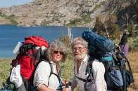 Photographers Nita Winter and Rob Badger Backpacking to photograph wildflowers in the Carson Pass area (background: Lake Winnamucca, Carson Pass, Eldorado National Forest, Sierra Nevada Mountains, California). Photograph by unknown fellow hiker.