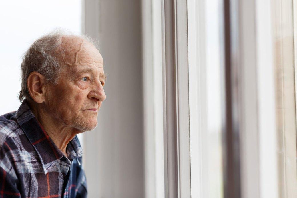 senior man sitting alone