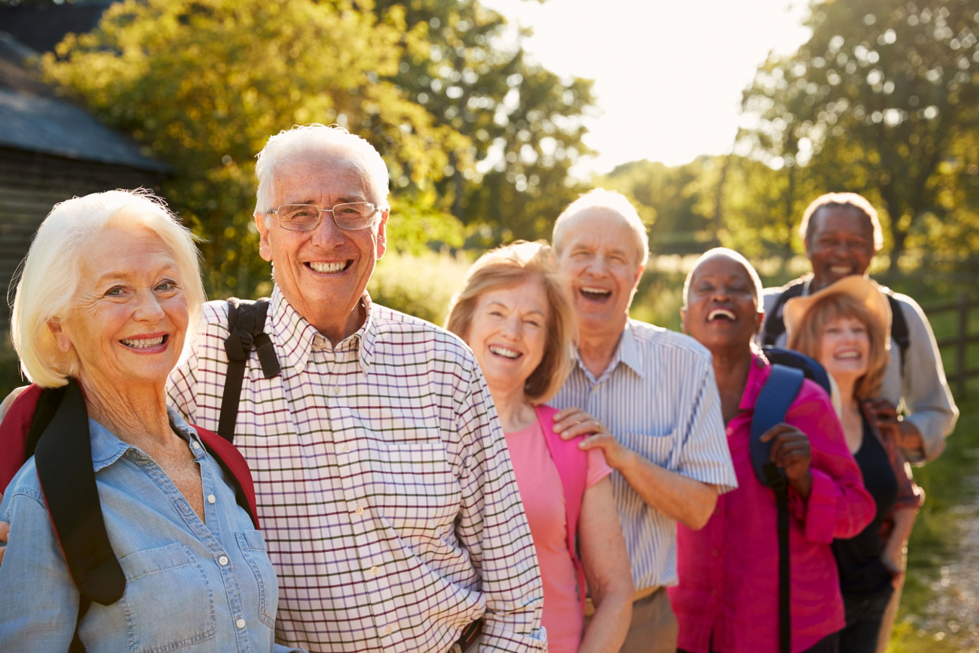 A group of happy seniors hiking outdoors