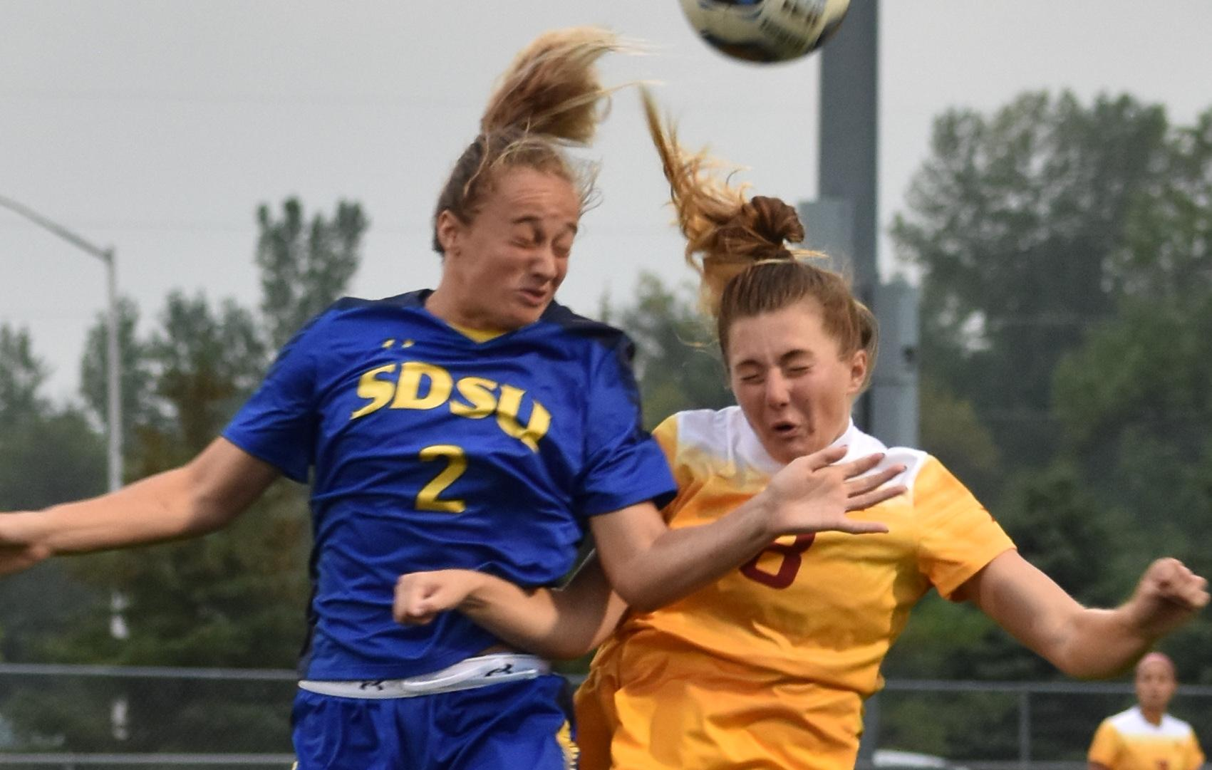 ABBY FULLENKAMP Kyli Nelson (2) goes to head-butt the ball blocking Iowa State University midfielder Anna Frerichs (8) during the game Sept. 1. The South Dakota State soccer team has won five straight games and is 3-0 in the Summit League. They face the Fort Wayne Mastodons at 6 p.m. Thursday at Fishback Soccer Park. The Jacks are in second place in the Summit League with four games left in the regular season.