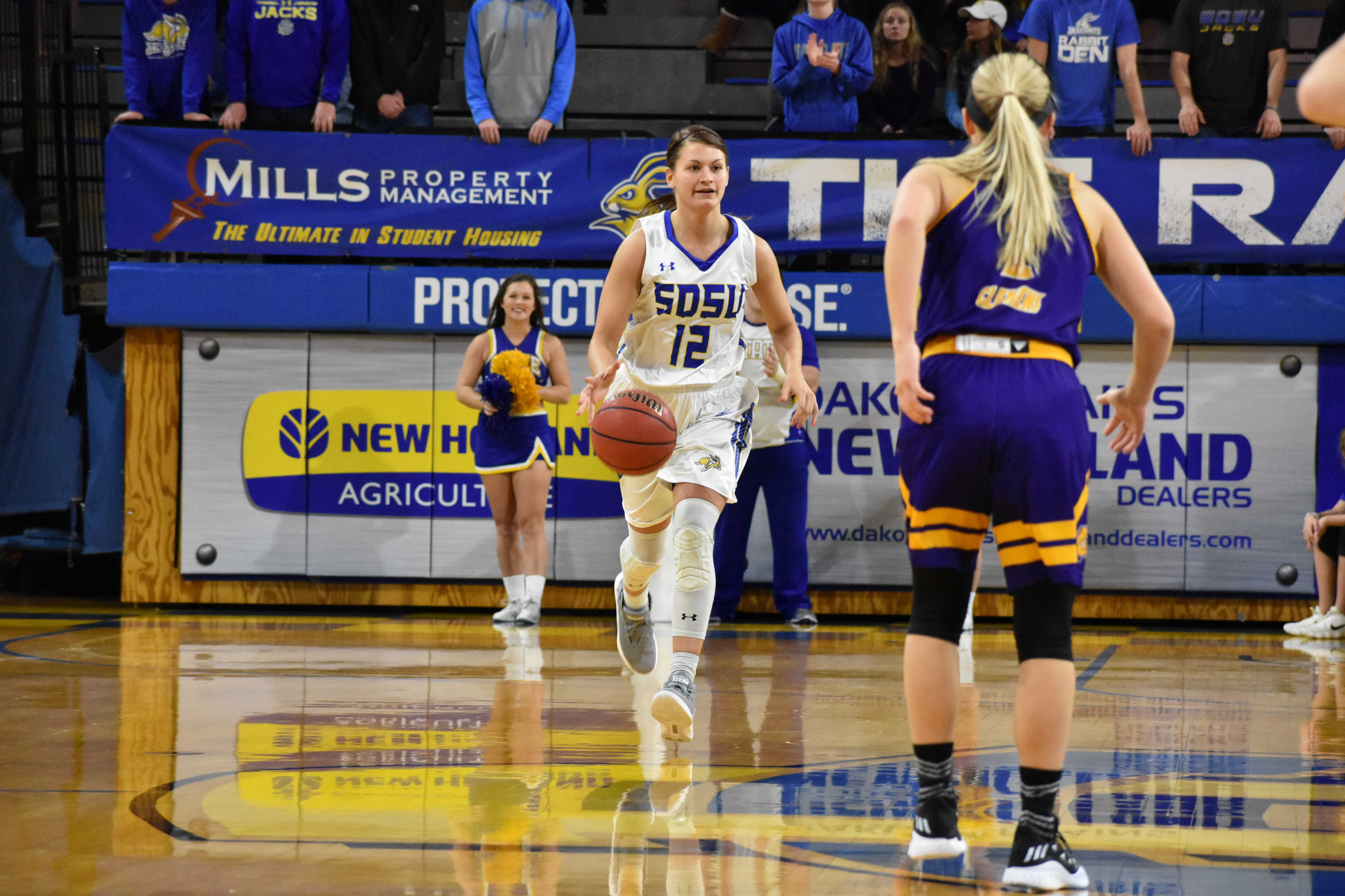 ABBY FULLENKAMP Redshirt junior guard Macy Miller (12) drives the ball down the court during the first half of the game against Western Illinois Saturday, Jan. 20. SDSU won 84-48.