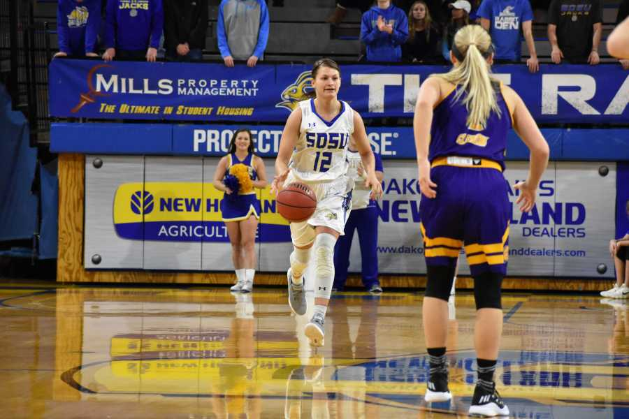 ABBY+FULLENKAMP%0ARedshirt+junior+guard+Macy+Miller+%2812%29+drives+the+ball+down+the+court+during+the+first+half+of+the+game+against+Western+Illinois+Saturday%2C+Jan.+20.+SDSU+won+84-48.+