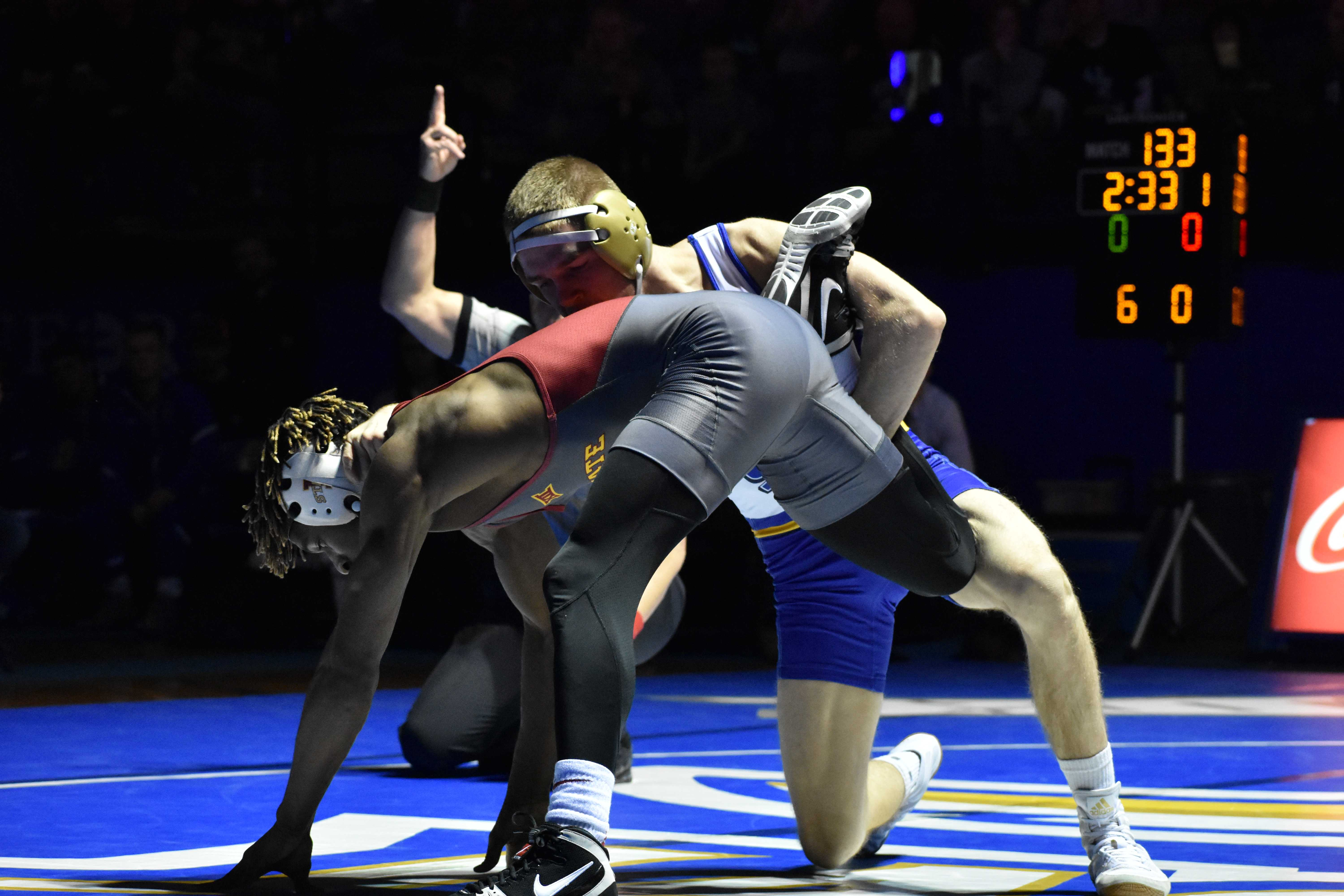 ABBY FULLENKAMP Junior Seth Gross wrestles against Iowa State Markus Simmons during the 133-pound bout Feb. 4. Gross defeated Simmons with a major decision of 12-3. The Jacks host NDSU at 7pm Friday, Feb. 16 in Frost Arena.