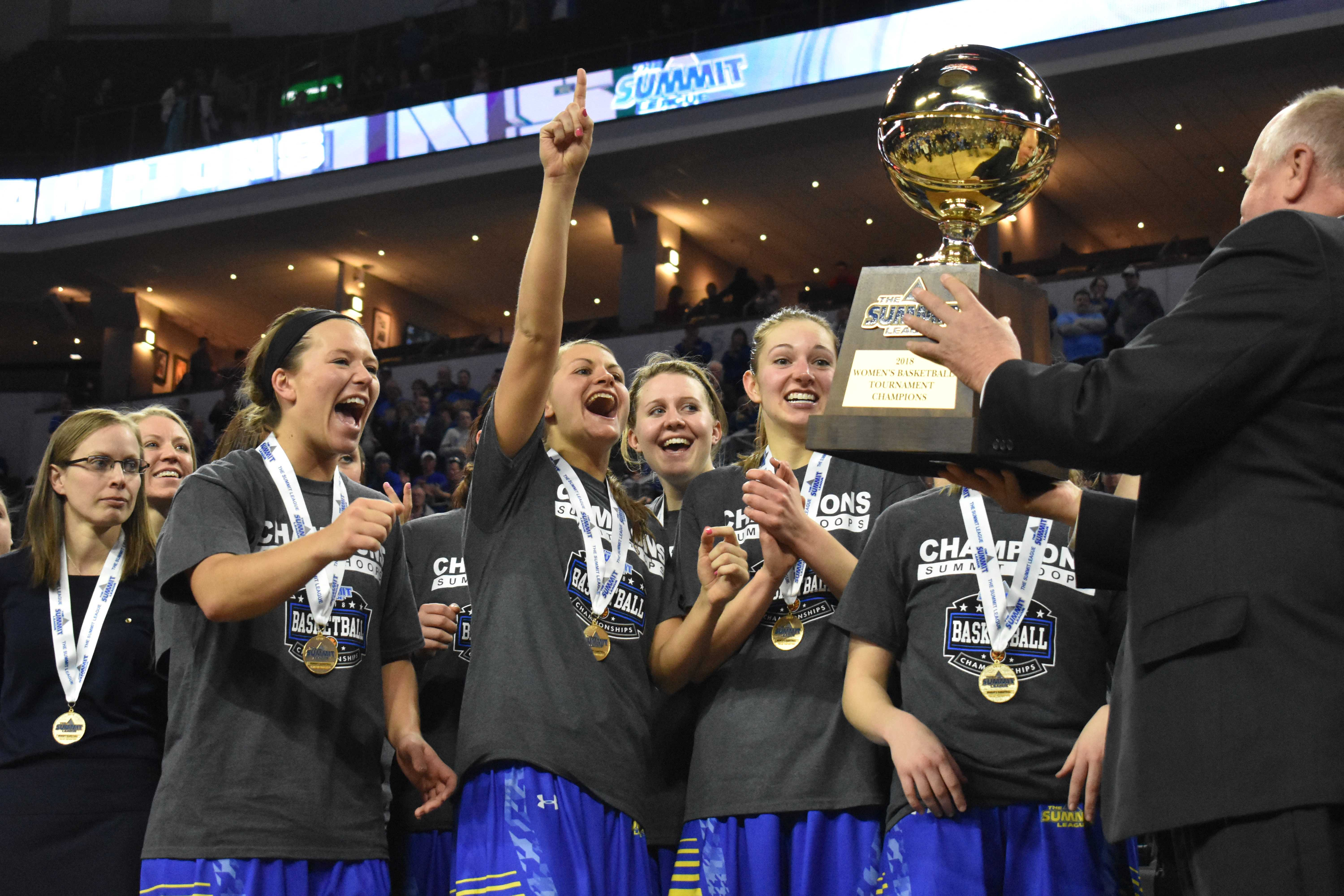 ABBY FULLENKAMP The Jacks are presented the Summit League Championship trophy March 6 at the Denny Sanford PREMIERE Center. The Jacks beat the Coyotes 65-60. SDSU faces Villanova in the first game of the NCAA Tournament at 6:30 p.m. March 16 in Notre Dame, Indiana.