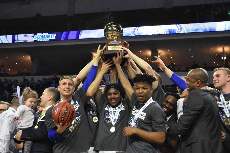 ABBY+FULLENKAMP+Beau+Brown%2C+David+Jenkins+Jr.+and+Brandon+Key+hold+the+Summit+League+Championship+trophy+on+March+6.+SDSU+defeated+USD+97-87.+