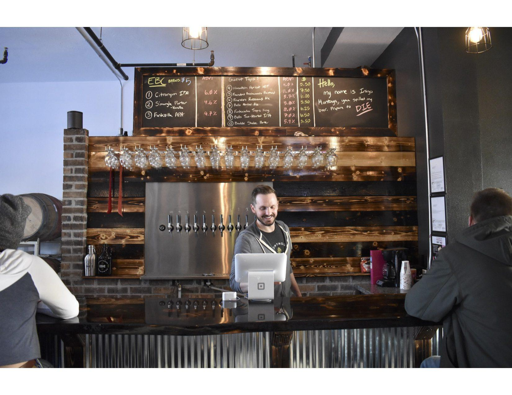 ABBY FULLENKAMP Owner Kyle Weber servers customers March 12 at Eponymous Brewing Co. Eponymous opened up March 2018 and is located in The Lofts at Main, 126 S. Main Ave.