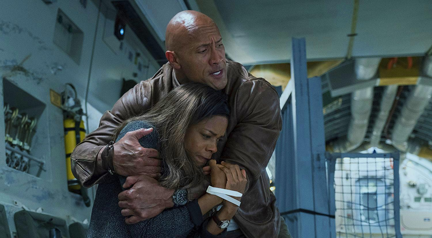 """WARNER BROS. PICTURES Dwayne """"The Rock"""" Johnson stars as a primatologist with an agenda in """"Rampage."""" The movie smashed through competition to take the number one spot for the weekend box office, outpacing fan favrite """"A Quiet Place"""" with $35.9 million."""