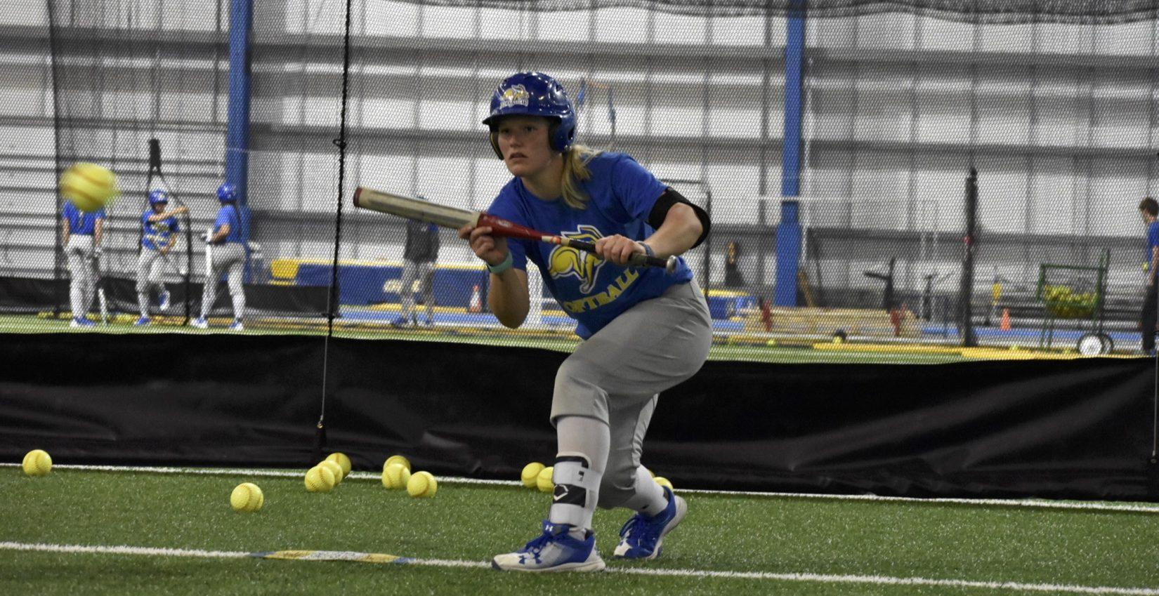 ABBY FULLENKAMP Junior Ali Herdliska readies to bunt the ball during practice April 9 in the SJAC. The Jacks face Western Illinois April 28 and 29 in Macomb, Illinois. SDSU is 27-12 overall and 8-3 in the conference.
