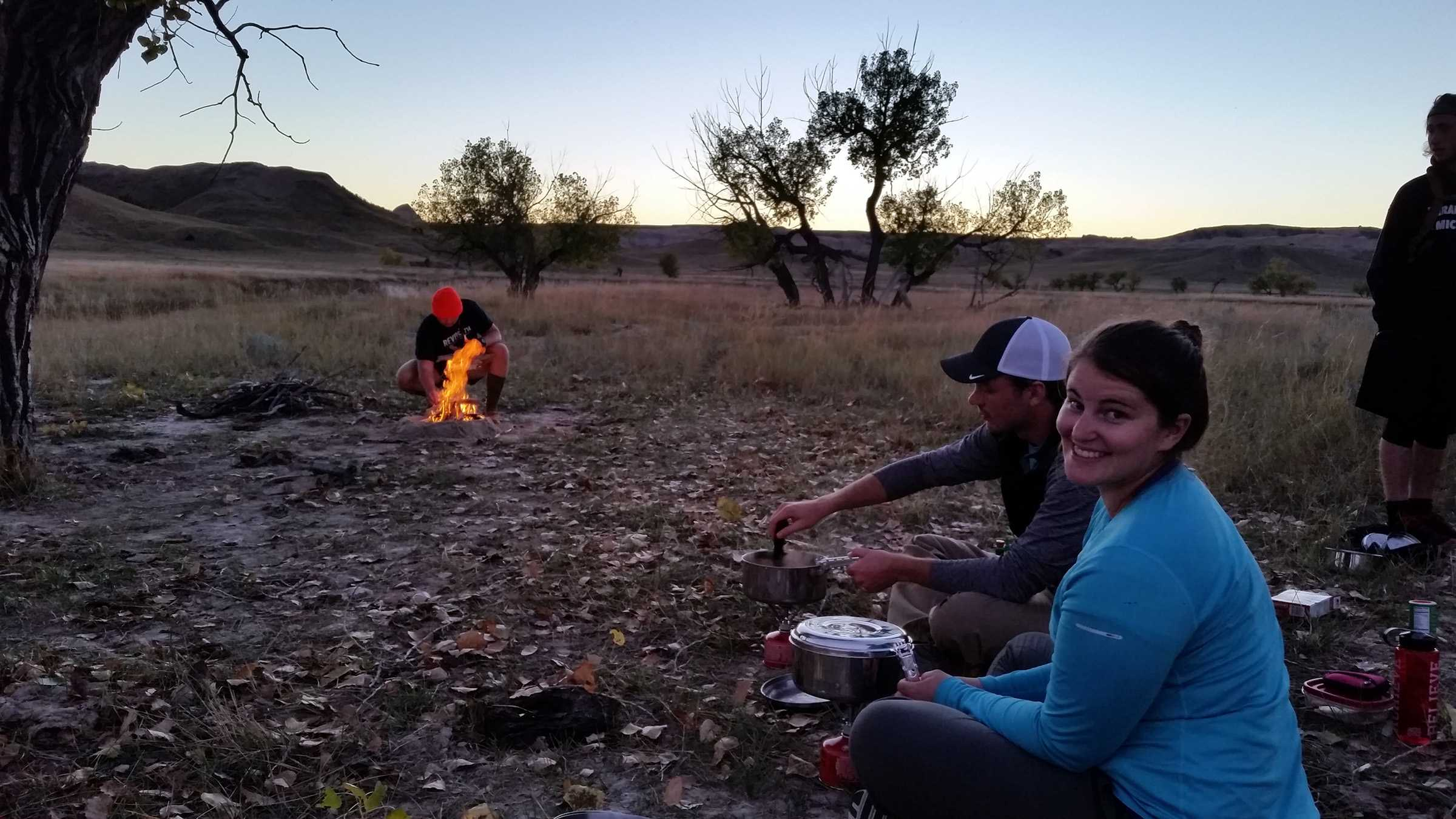 SUBMITTED Amy Cornish prepares a meal over a fire while camping on the 2016 trip to Buffalo Gap National Grasslands near Scenic, SD.