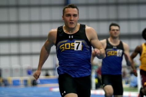 Former football recruit breaks records in track and field