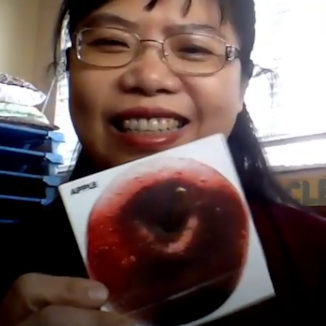 teacher with picture of apple