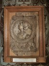 carved wooden panel